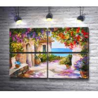 Двор с вьющимися цветами на берегу моря