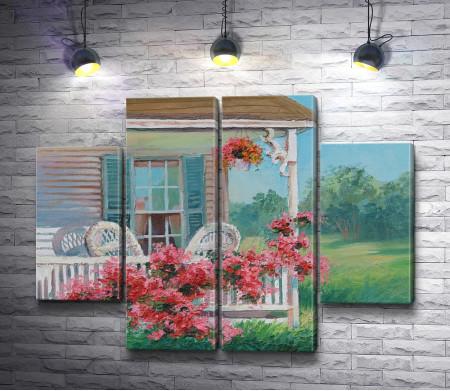 Дом со стульями на крыльце и клумбой цветов