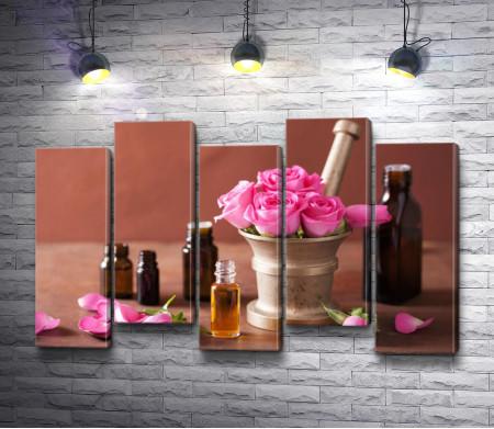 Эфирные масла в баночках и букет роз