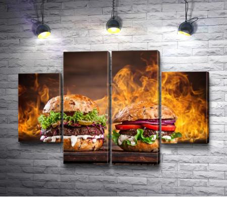 Два бургера на фоне огня