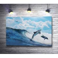 Дельфины резвятся на волнах и чайка пролетает над ними
