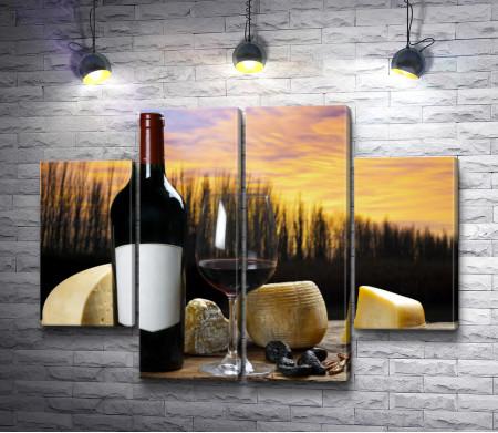 Итальянский натюрморт: бутылка вина, бокал, сыр, сухофрукты