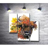 Голова быка в осенних листьях и рябине