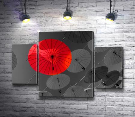 Весящий красный зонт с черно-белыми