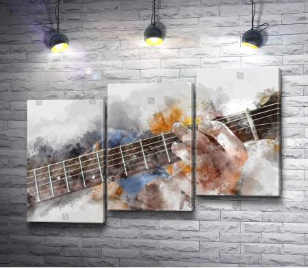 Гитарист играет на гитаре
