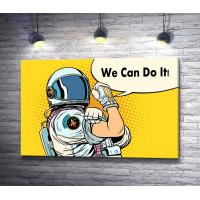"""Космонавт демонстрирует мускулы и надпись """"We сan do it"""""""
