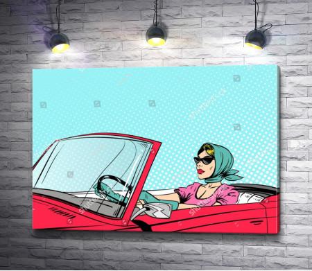 Модная девушка за рулем красного кабриолета