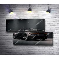 Черный спортивный автомобиль