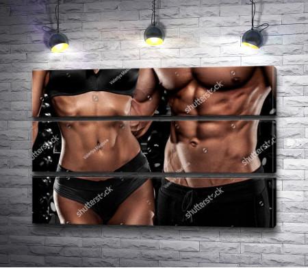 Парень и девушка с красивыми накаченными телами