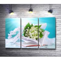 Свадебная композиция из букета подснежников и книги