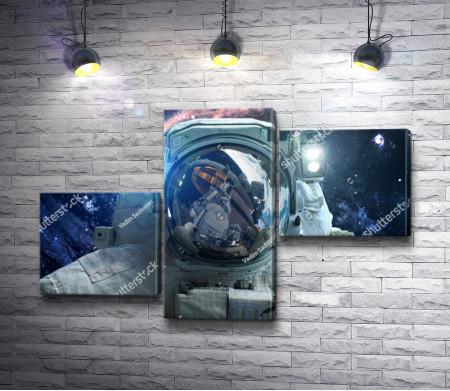 Фотография астронавта в открытом Космосе