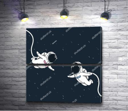 Два астронавта в открытом Космосе