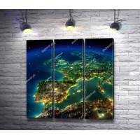 Вид на ночную Землю из иллюминатора шаттла