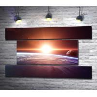 Рассвет над планетой в Космосе