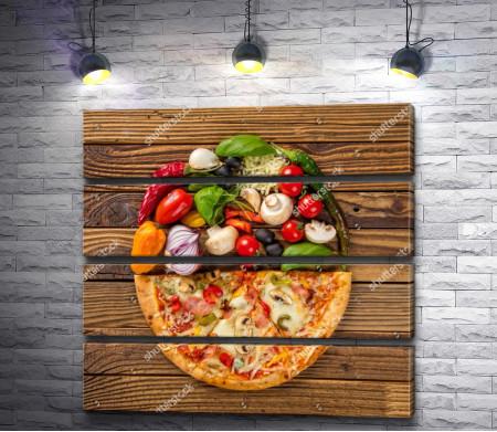 Половинка пиццы и свежие овощи