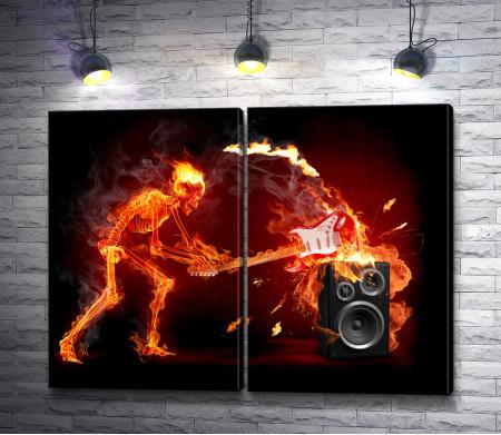 Огненный скелет разбивает гитару об колонку