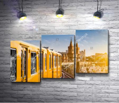 Желтый трамвай на фоне моста Обербаумбрюкке, Берлин