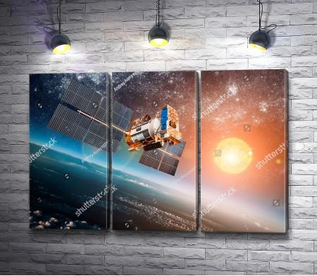 Космический шаттл на орбите Земли в лучах Солнца