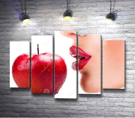 Губы и красное яблоко