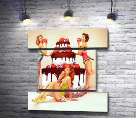 Девушки возле огромного торта