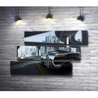 Автомобиль Mercedes-AMG Project One  на улице мегаполиса