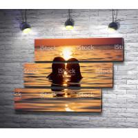 Вечернее купание двух влюбленных
