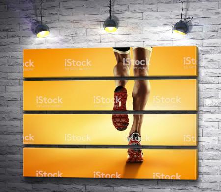 Ноги спортсмена бегуна