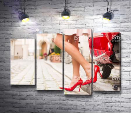 Женские ноги в красных туфлях