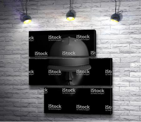 Темное лицо в кепке