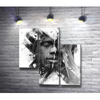 Африканский мужчина в с символикой на лице