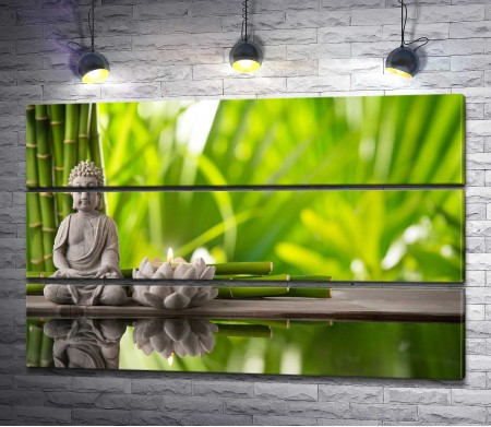 Статуэтка Будды и бамбук