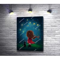 Девочка и собака смотрят на звездное небо