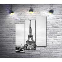 Эйфелева башня на фоне Парижа