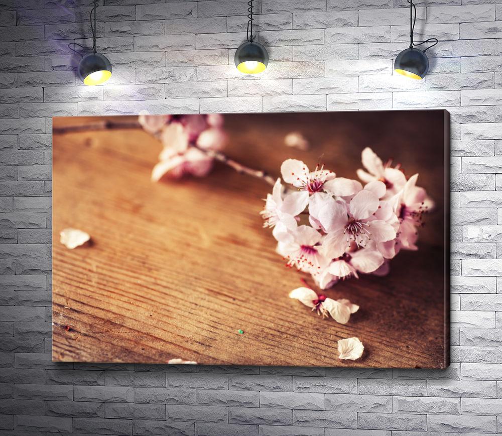 """Картина """"Ветка цветущей сакуры на деревянном столе"""""""